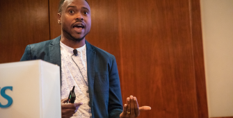Tiq Milan delivers keynote address at OutNEXT 2018 Global Summit
